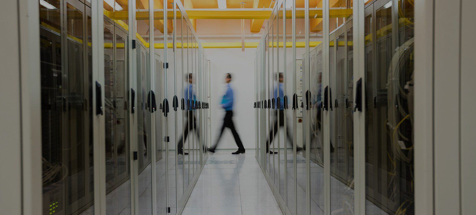 Man walking through server room